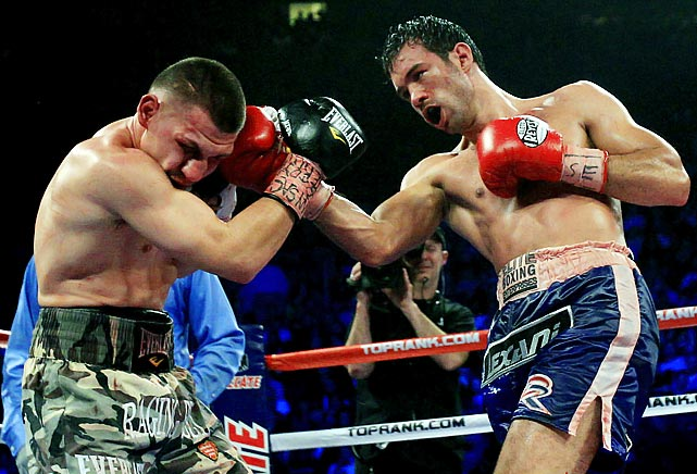 Wolak, a full-time construction worker, took his lunch-pail approach into the ring against Rodriguez, a former world title challenger making his 154-pound debut. Over 10-action packed rounds, the two exchanged bombs in a fight that looked to be on the verge of being stopped countless times. Fittingly, with Rodriguez's face battered and a softball-sized knot bulging around Wolak's right eye, the fight was ruled a draw. Rodriguez would win a convincing decision in the rematch in December ( pictured ), after which the 30-year-old Wolak announced his retirement.