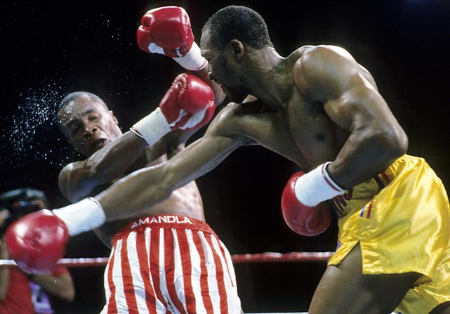 "Leonard retains WBC title; Hearns retains WBO title.  The legends are rematched eight years after their historic unification battle at welterweight. While both are past their primes, they produce a thrilling duel, with Leonard, 35-1, suffering knockdowns in rounds three and 11, and Hearns, 46-3, barely surviving round 12. Almost no one agrees with the decision, including Leonard, whose thought before the announcement of the decision is, ""The only uncertainty left was the margin of [my] defeat."""