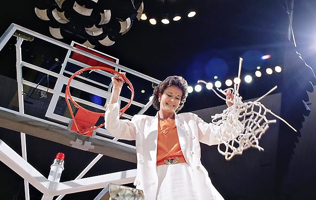 Pat Summitt and Tennessee celebrated their third national championship in five years with a 70-67 overtime victory over Virginia.