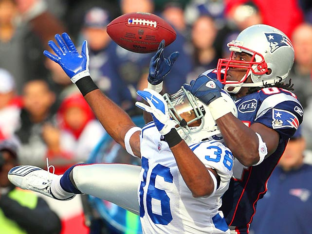 Patriots receiver Deion Branch and Indianapolis cornerback Chris Rucker battle for a pass during New England's 31-24 victory.
