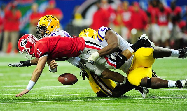 LSU defensive tackle Michael Brockers forces Georgia quarterback Aaron Murray to fumble during the SEC championship game. Murray also threw two interceptions as the Tigers rolled to a 42-10 win.