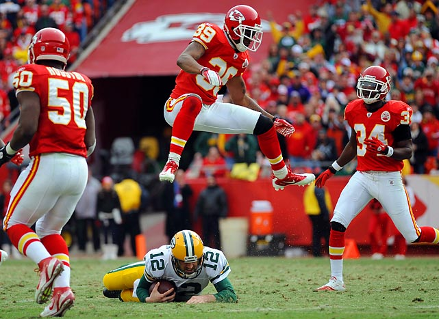 Chiefs cornerback Brandon Carr jumps over Green Bay quarterback Aaron Rodgers at Arrowhead Stadium in Kansas City on Dec. 18. Carr and the Chiefs won 19-14 to hand the Packers their first loss of the 2011 season.