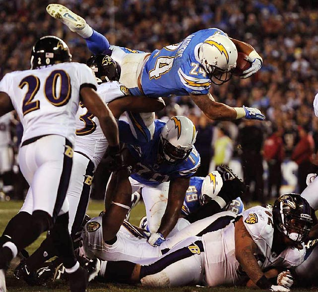 Chargers halfback Ryan Matthews (top) leaps into the end zone during San Diego's 34-14 beatdown of the Baltimore Ravens. Matthews scored two touchdowns on the ground in the contest.
