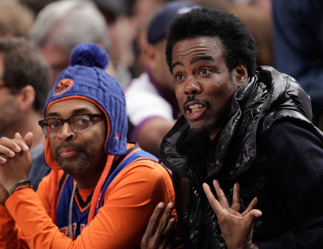 Spike Lee (far left) and Chris Rock clearly weren't pleased with the Knicks, as they gave up a 10-point lead at the half to fall behind by eight in the third.
