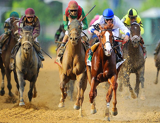 And they're off! Shackleford (blue cap) stormed out to an early lead, but Animal Kingdom (red cap) won the 137th running of the Kentucky Derby on May 7.