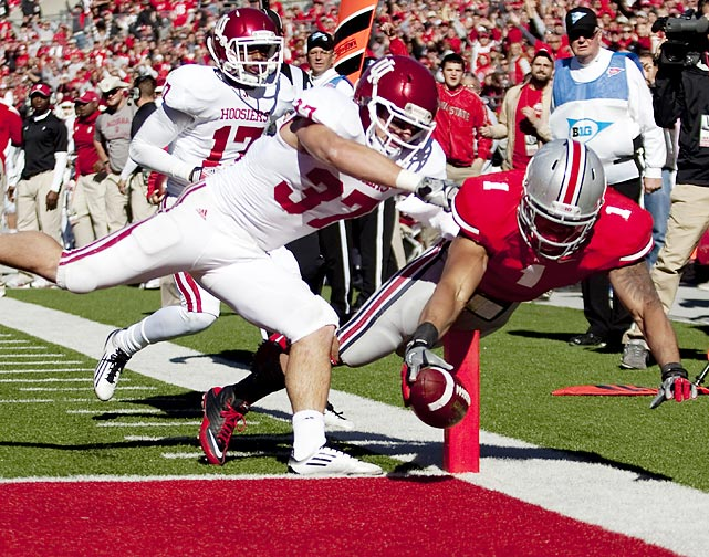 Ohio State running back Dan Herron vaults past Indiana linebacker Mark Murphy for a touchdown during their game on November 5. Herron, who finished with 141 yards, was one of three Buckeyes to eclipse the 100-yard mark in the team's 34-20 conference win.