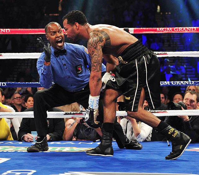 Shane Mosley staggers to his corner during a May 2011 bout against Manny Pacquiao. Pacquia won via unanimous decision, successfully defending his WBO welterweight title.