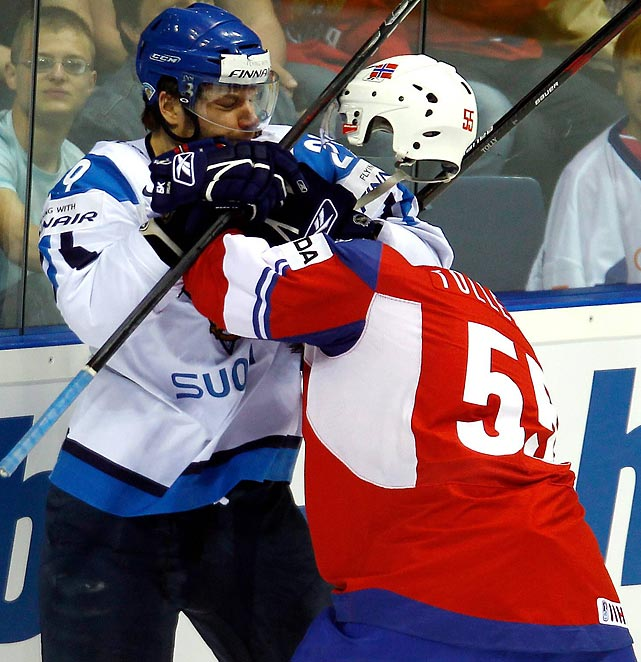 Finland's Petteri Nokelainen gets into a fight with Norway's Ole Kristian Tellefsen during the IIHF World Championship in May. Finland won the game 4-1 -- and the title just three days later.