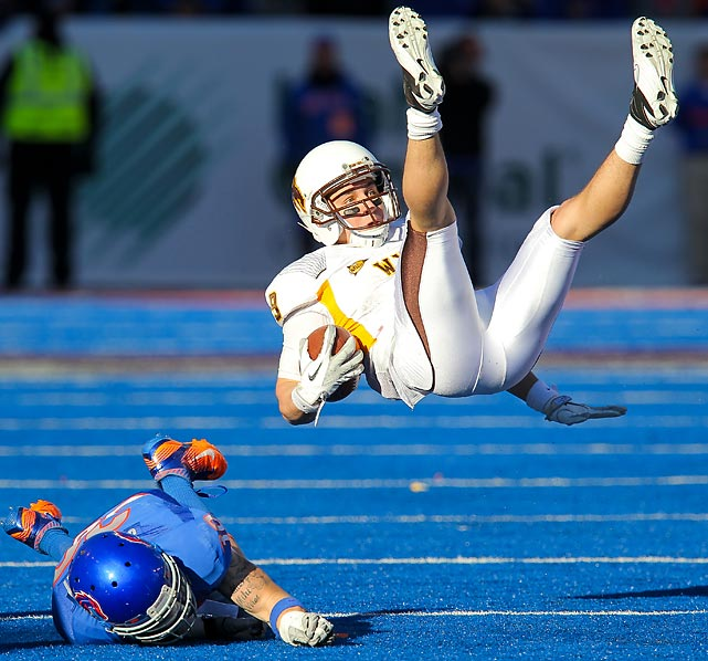 Wyoming wideout Sam Stratton flips into the air after being hit by Boise State safety Travis Stannaway during their game on Nov. 26. The Broncos won 36-14 to improve to 10-1.