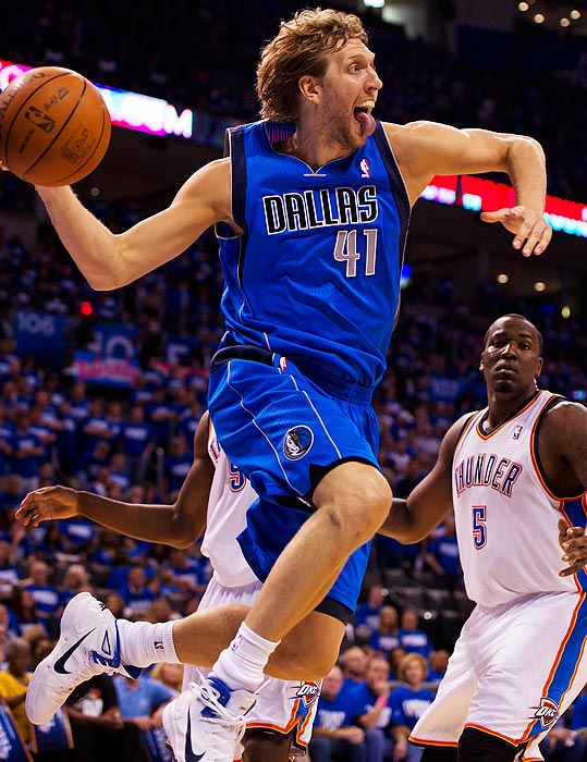 Dirk Nowitzki soars past Oklahoma City in the Western Conference Finals, helping the Mavericks oust the Thunder in a five-game series. He went on to average 26 points in Dallas' NBA Finals victory over Miami.