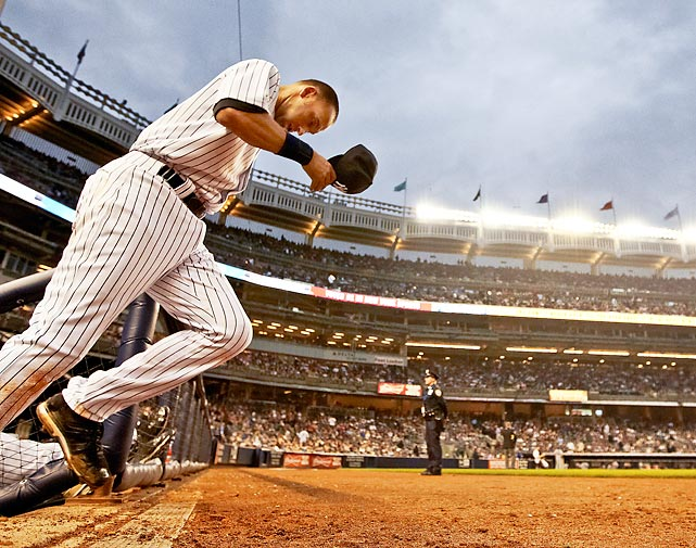 Yankees' shortstop Derek Jeter takes the field following his 3,000th hit milestone against the Tampa Bay Rays on July 9. He did it in style. New York's captain belted a home run against David Price, part of a memorable 5-for-5 day at the plate.