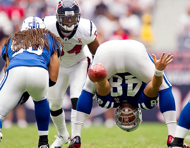 Indianapolis' Justin Snow snaps the ball in a matchup with the Houston Texans, an eventual loss. it was one of many. The Colts have struggled mightily in quarterback Peyton Manning's absence due to injury.
