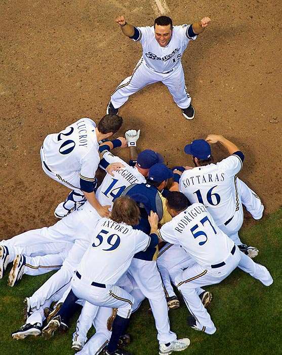 The Milwaukee Brewers celebrate after eliminating the Arizona Diamondbacks to advance to the NLCS. Outfielder Nyjer Morgan hit a 10th inning RBI single to seal the decisive 3-2 victory.