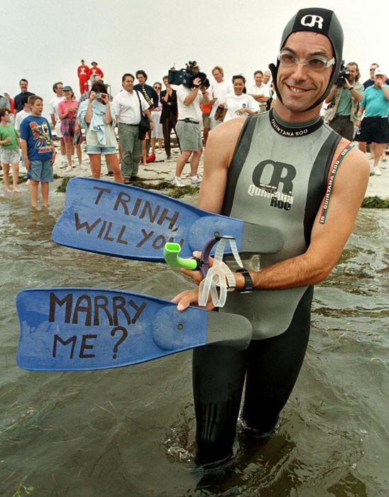 Unable to come up with the right words, transatlantic swimmer Benoit Lecomte uses his flippers to propose to girlfriend Trinh Dang.