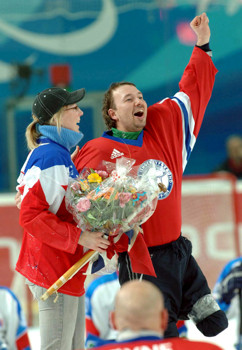Norwegian hockey player Helge Bjornstad celebrates with Kathrine Bolstad after she accepted his marriage proposal at the end of 2006 Winter Paralympic Games win over Italy.