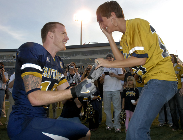 "Tennessee Chattanooga receiver Blue Cooper proposes to Maci Gault after a 2009 game against Citadel. No word on whether or not teammates shouted, ""You're my boy, Blue!"""