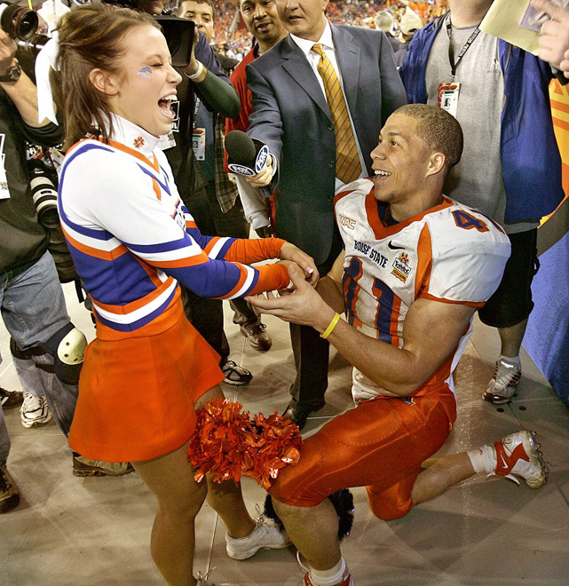 Boise State running back Ian Johnson proposes to his cheerleader girlfriend Chrissy Popadics after helping the Broncos defeat the Oklahoma Sooners 43-42 in the 2007 Fiesta Bowl.