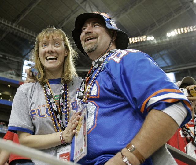 Colleen Sander and Darion Glover smile after a successful marriage proposal at the 2007 BCS National Championship game between Ohio State and Florida.