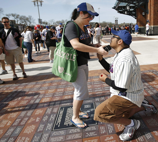 Anthony McNally proposes to his girlfriend Lauren Gregory before a 2010 Mets-Marlins game at Citi Field.
