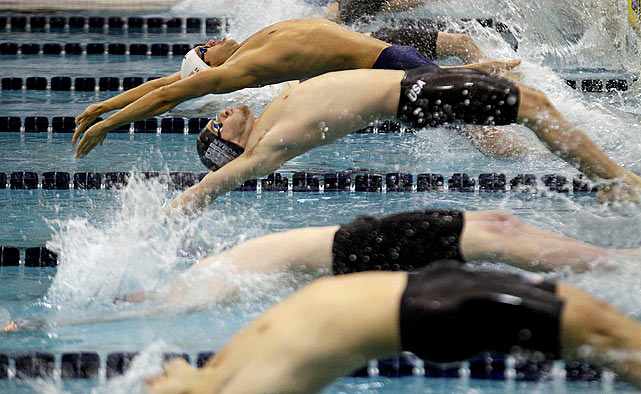 Matthew Grevers (top) explodes off the starting block en route to a first-place finish in the men's 100-meter backstroke on Friday Dec. 2.