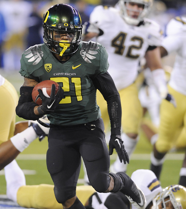 LaMichael James (pictured) ran for 219 yards and three touchdowns as Oregon locked up a Rose Bowl bid with a one-sided win over UCLA on Friday in the inaugural Pac-12 Championship Game.