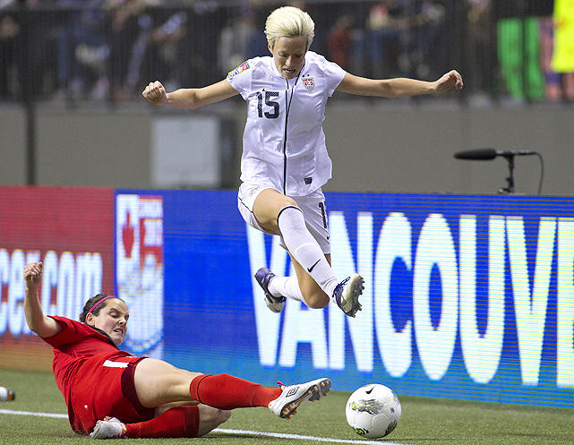 The U.S. faced Canada in the CONCACAF Olympic qualifying finals - a more relaxed match than the semifinals since both teams will be going to the London Olympics. Megan Rapinoe leaps over Canada's Rhian Wilkinson, just like the U.S. leaps over Canada 4-0 for the tournament win.