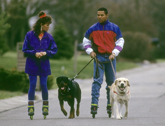 Walking two dogs while rollerblading? Larkin, shown here with wife Lisa, was clearly the epitome of cool.