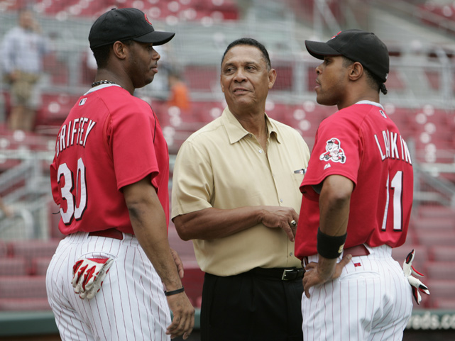 Larkin and Griffey, Jr. chat before a May 2004 game with Reds legend Tony Perez. Larkin and Griffey, Jr. both graduated from Cincinnati's Moeller High, though they didn't attend at the same time.