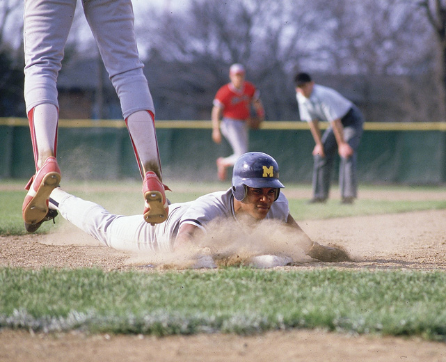 Barry Larkin slides back to first while playing for the University of Michigan in 1985. Larkin, who was originally recruited to play football by late Michigan coach Bo Schembechler, was on the Wolverine baseball team from 1983 to '85.