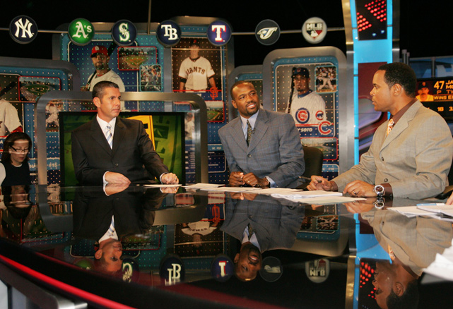Larkin (right) hosts  Hot Stove  on the MLB Network with Victor Rojas (left) and Harold Reynolds (center). Larkin left MLB Network to join ESPN as an analyst in 2011.