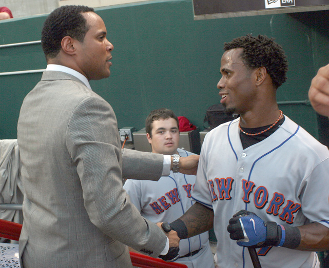 Larkin shakes hands with then-Mets shortstop Jose Reyes after being inducted into the Reds Hall of Fame in July 2008. Larkin was a three-time Gold Glove winner and the 1995 NL MVP.