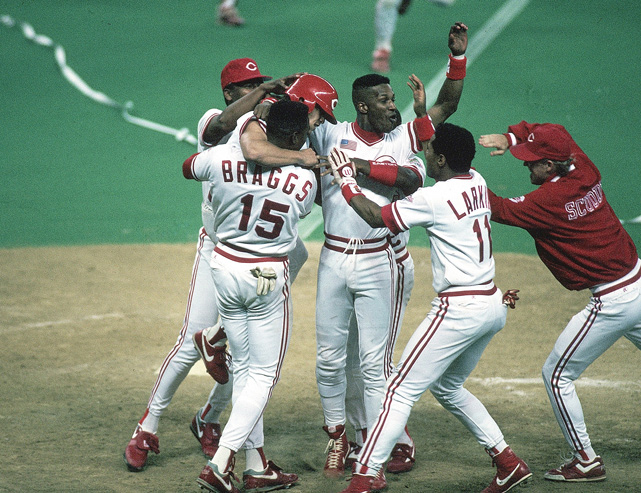 Larkin celebrates with Eric Davis (44) and Glenn Braggs (15)  after winning Game 2 of the World Series in the 10th inning. The Reds swept the series in four games.