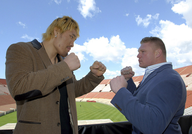 Lesnar poses with South Korean fighter Hong-Man Choi at a 2007 press conference announcing their bout at the L.A. Coliseum. Choi ended up getting replaced by fellow South Korean Min Soo Kim prior to bout. No problem for Lesnar: He submitted Kim due to strikes in just over a minute.