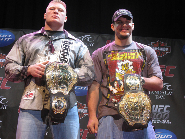 Lesnar glares while on stage with Frank Mir ahead of their 2009 Heavyweight Championship bout at UFC 100. Brock knocked the smile right off Mir's face in the octagon, retaining his belt by knocking Mir out.