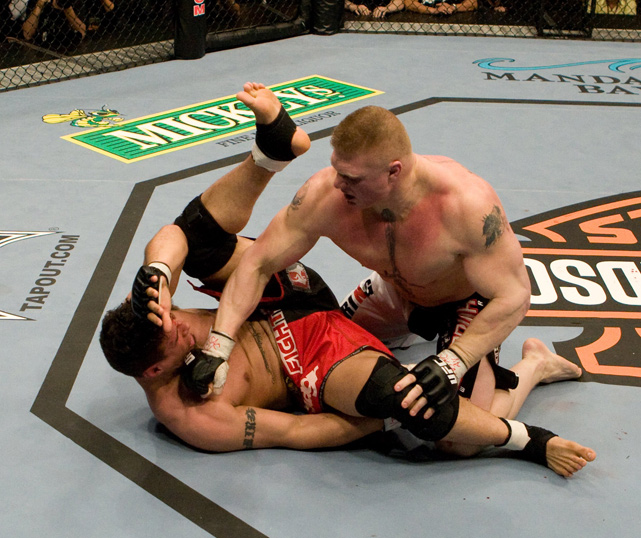 Lesnar hits Mir during his UFC debut in February 2008. Lesnar lost the fight by submission in the first round.