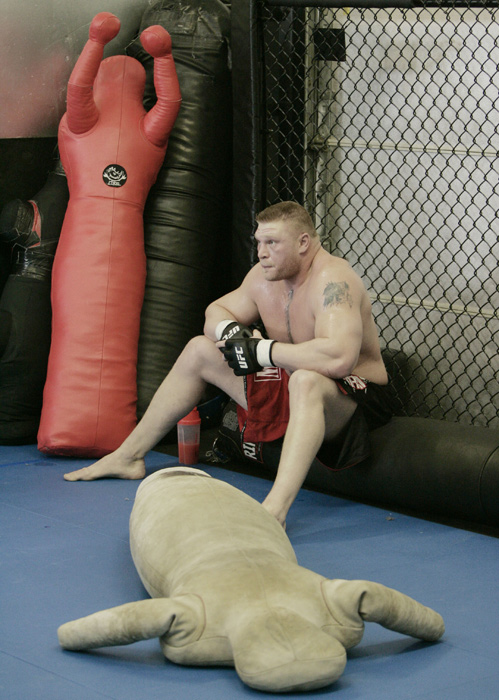 Lesnar takes a quick breather after KO'ing a practice dummy during training.