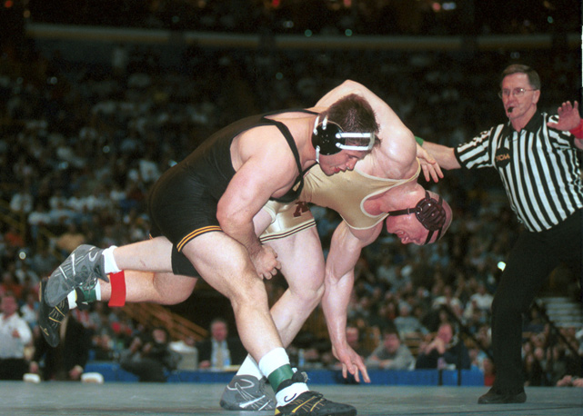 Lesnar, wrestling for the University of Minnesota, takes down Iowa's Wes Hand in the NCAA's 285 pound weight class championship in March 2000. Lesnar won the match and the national title to finish his college career with a 106-5 record.