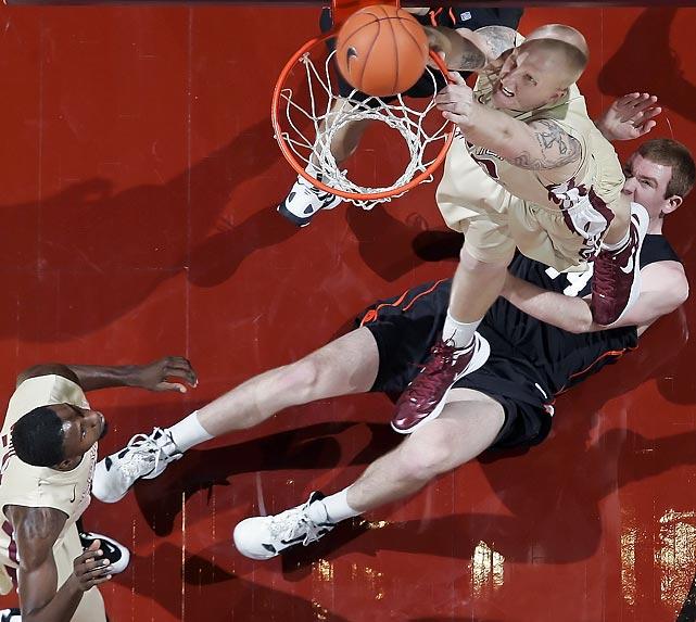 Florida State center Jon Kreft misses a dunk while Princeton forward Ian Hummer lies defenseless.