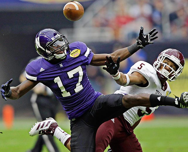 Northwestern wide receiver Rashad Lawrence (17) battles Texas A&M defensive back Coryell Judie for a ball that Lawrence for a first down. Texas A&M came out on top, 33-22, in the Meineke Car Care Bowl at Reliant Stadium in Houston.