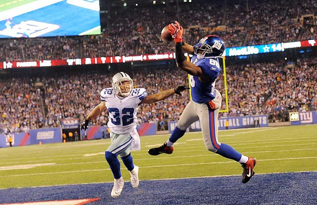 Hakeem Nicks of the New York Giants beats Orlando Scandrick of the Dallas Cowboys for a game-sealing touchdown in Sunday's 31-14 win that decided the NFC East title.