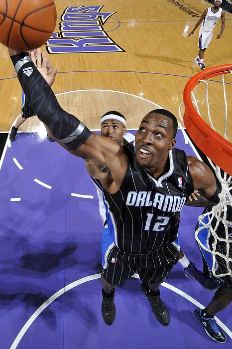 Orlando center Dwight Howard snags a rebound in the Magic's 104-97 victory at Sacramento. Howard got into early foul trouble and only had five points and four rebounds in the win.