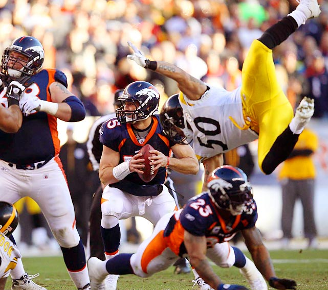 Tim Tebow gears up for a throw as Steelers linebacker Larry Foote is cut down by Broncos running back Willis McGahee in Sunday's AFC Wild-Card matchup. Tebow finished with 316 passing yards and three total touchdowns in Denver's 29-23 overtime win.