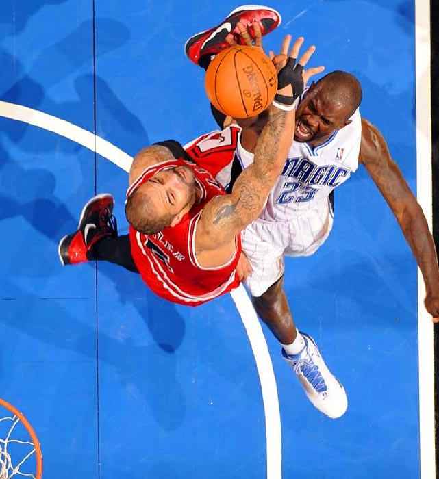 Magic guard Jason Richardson puts up a contested shot against Chicago's Carlos Boozer on Friday at Amway Arena. The Bulls handled Orlando 97-83.
