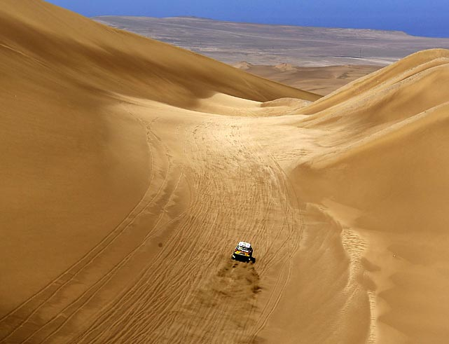 Spain's Nani Roma and French co-pilot Michel Perin drive in the 10th stage of the South American edition of the Dakar Rally.
