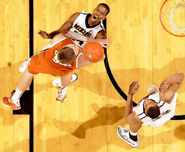Texas' Clint Chapman knocks down Missouri's Kim English in Mizzou's 84-73 win over the Longhorns.