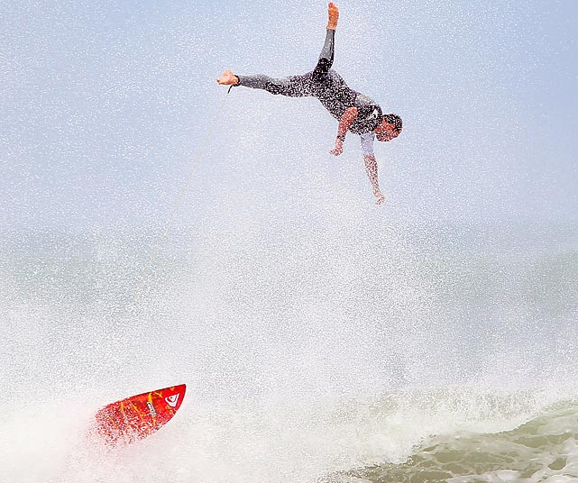 A surfer is thrown from his board while trying to catch a wave at the New Zealand Surfing Championships.