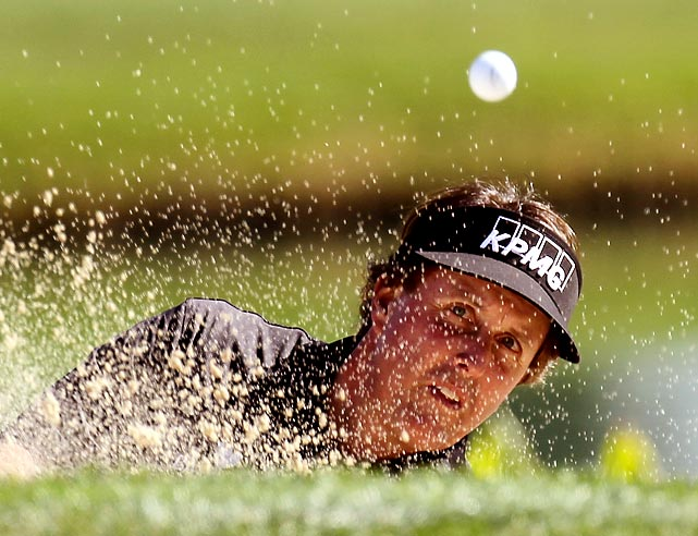 Phil Mickelson plays a bunker shot during the first round of the Humana Challenge.