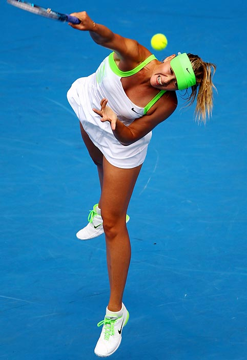 Maria Sharapova follows through on a serve during her third-round Australian Open win.