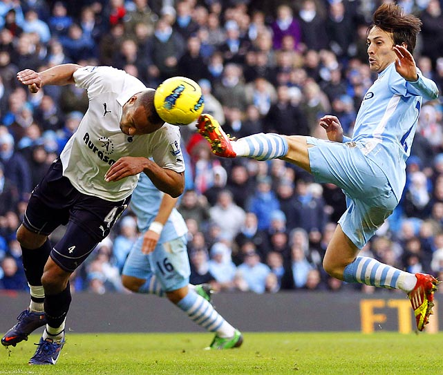 Manchester City's David Silva (right) challenges Tottenham's Younes Kaboul  during City's 3-2 Premier League win over Spurs.