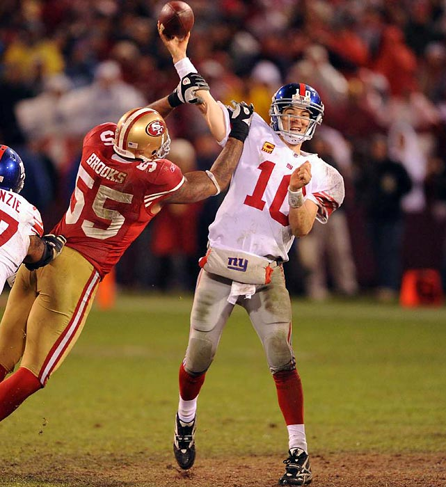 Giants quarterback Eli Manning passes under pressure from 49ers linebacker Ahmad Brooks.